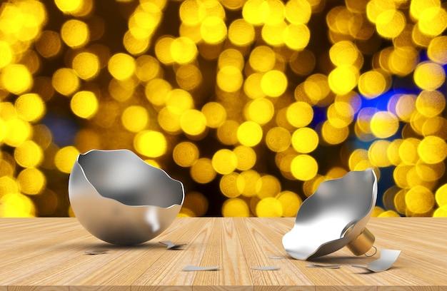Сломанный пустой серебряный шар и рождественские огни