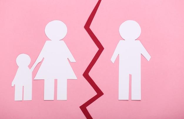 Broken family, divorce. deprivation of parental rights. split paper family on pink