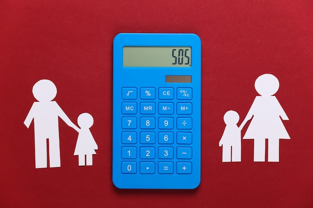 Broken family, divorce. property division concept. split paper family, calculator on a red