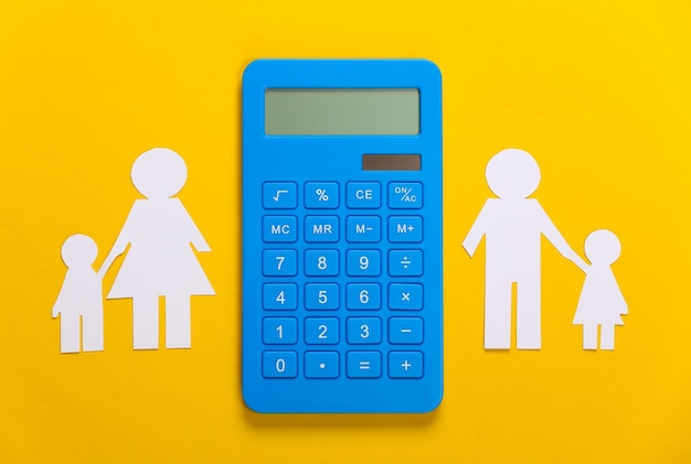 Broken family, divorce. property division concept. split paper family, calculator on yellow