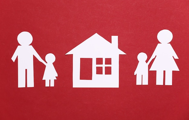 Broken family, divorce. property division. split paper family, house on a red