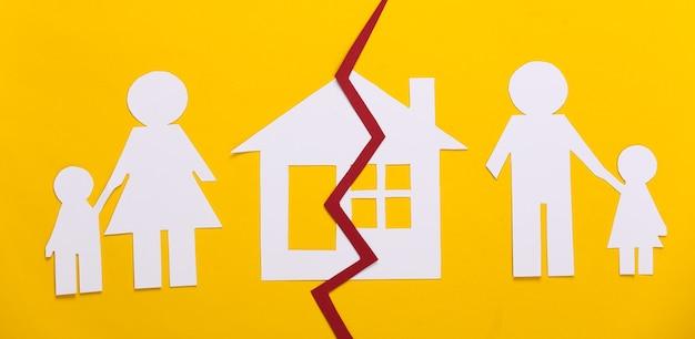 Broken family, divorce. property division. split paper family, house on yellow
