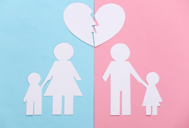 Broken family, divorce. split paper family, broken heart on blue pink pastel