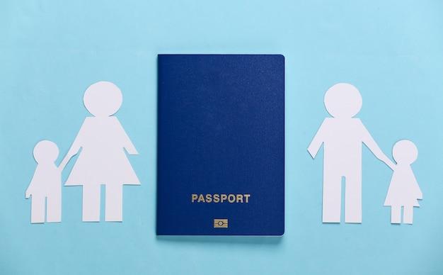 Broken family, divorce. split paper family, passport on blue