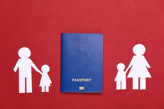 Broken family, divorce. split paper family, passport on a red