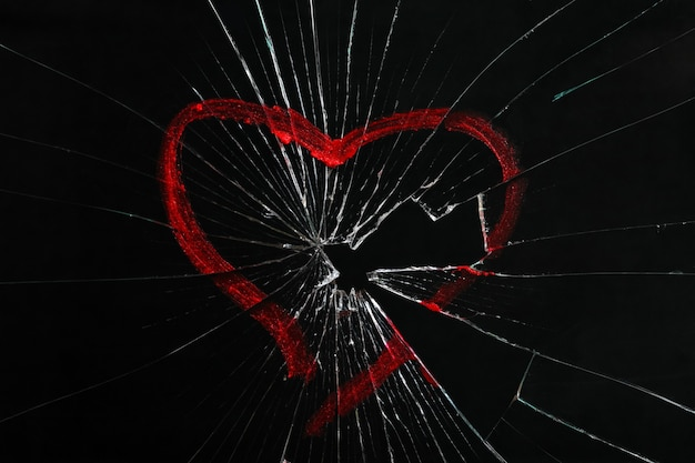 Broken glass with drawn heart