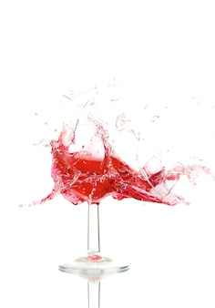Broken a glass with wine on a white wall