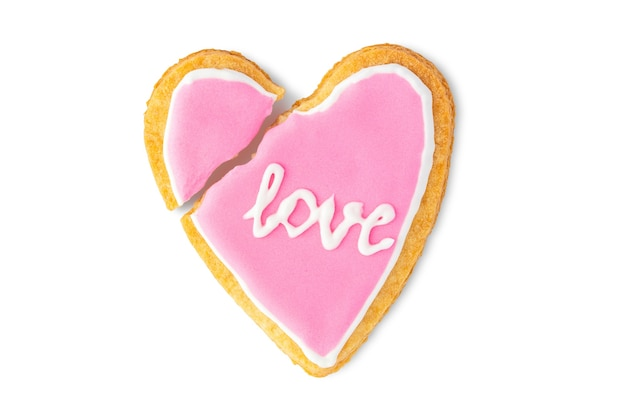 Broken heart cookie with text love isolated on white background Premium Photo