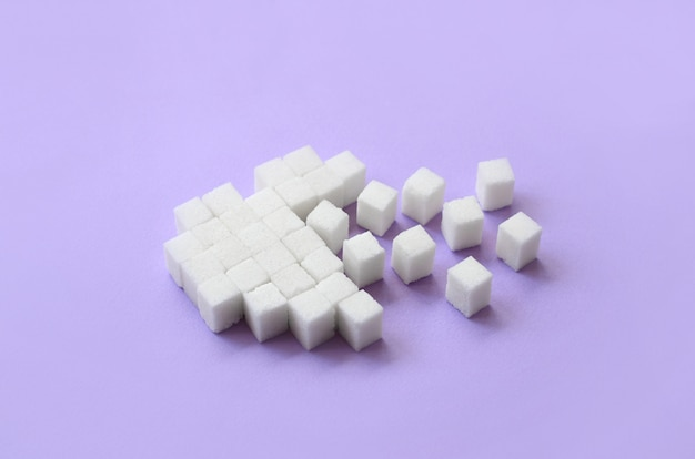 A broken heart made of sugar cubes