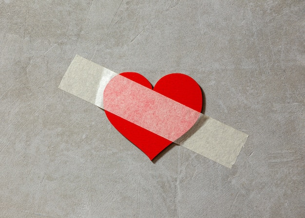 Broken heart sealed with duct tape