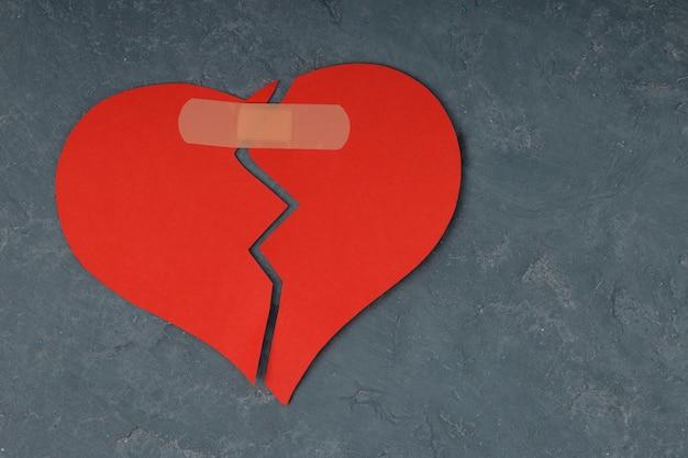 Broken heart shape with bandage