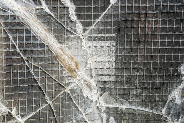 A broken industrial security window.