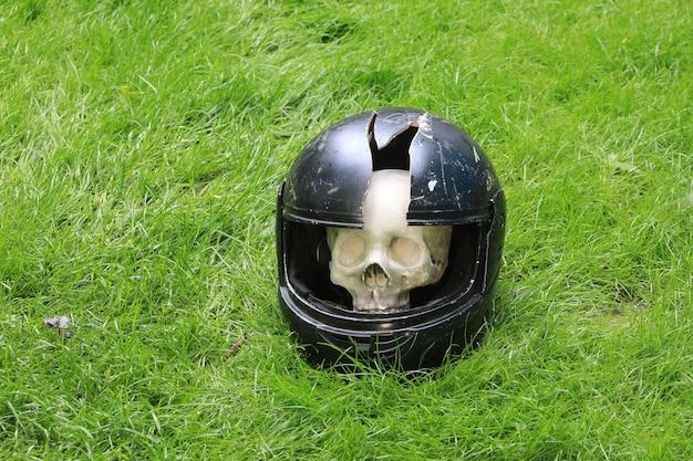 Broken motorcycle helmet on the ground