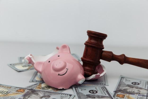 Broken piggy bank and judge gavel bankruptcy or crisis concept