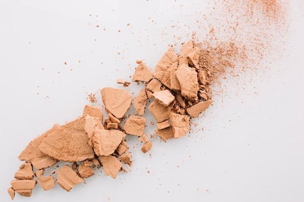 Broken powder on white background