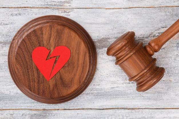 Broken red heart and gavel.