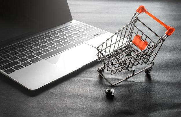 Broken shopping cart wheel with laptop
