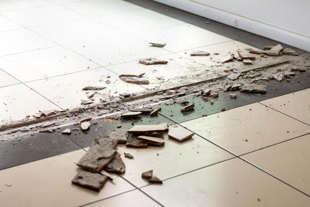 Broken tiles removing for repair.