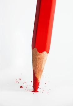 Broken tip of red pencil