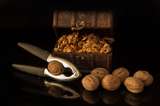 Broken walnuts in a retro styled old treasure chest