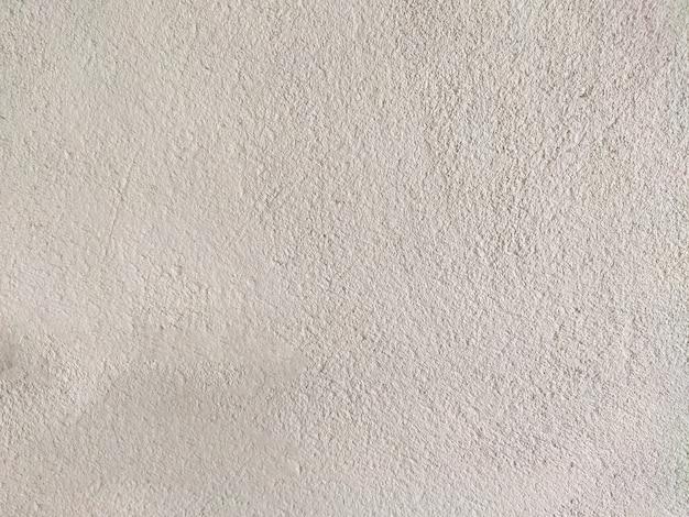 壊れた白いコンクリートの壁の背景