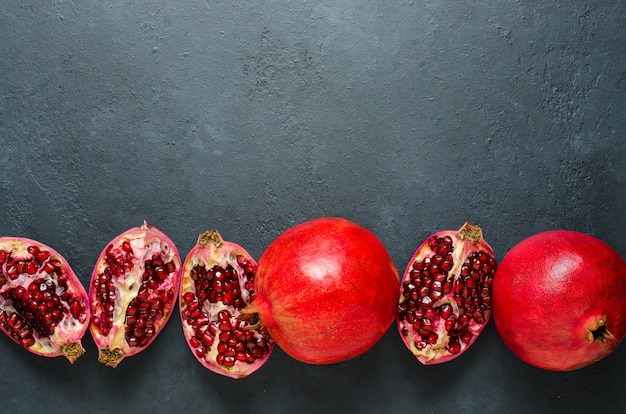 Broken and whole pomegranate fruit