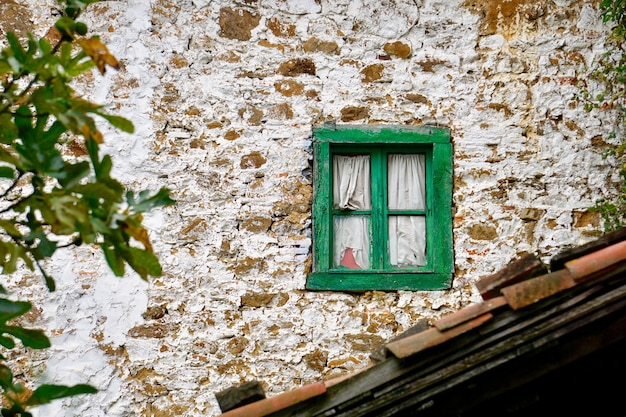Broken window on the abandoned house, architecture in bilbao, spain
