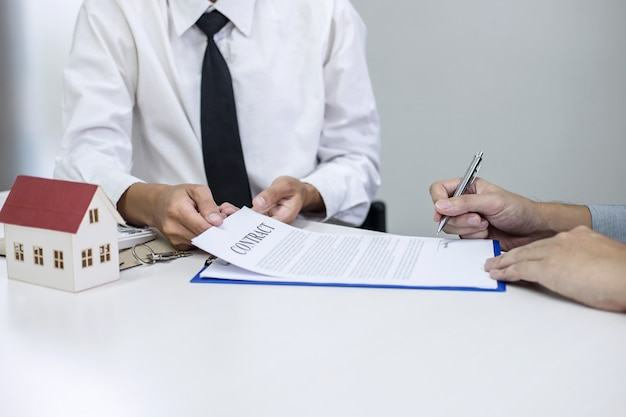 Broker agent presenting and consult to customer to decision making sign insurance form agreement