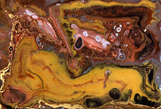 ブロンズとゴールドの霜降りパターン。黄金の大理石の液体テクスチャ。