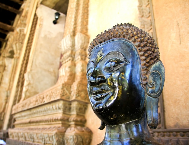 Bronze buddha statue at the haw phra kaew, vientiane