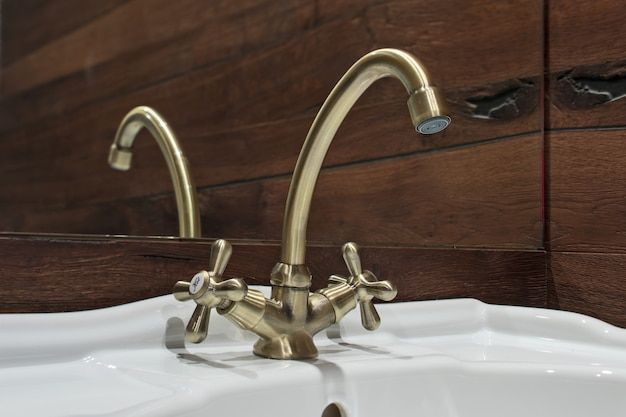 Bronze faucet in the bathroom washstand