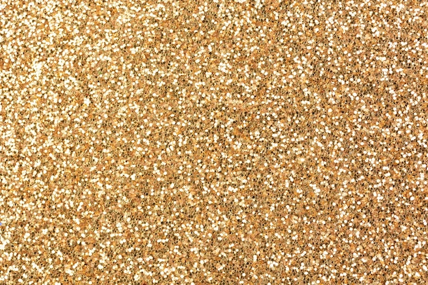Bronze glitter texture background, glitter or sandpapper high detailed surface, shining glowing effects concept photo