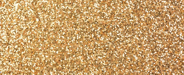 Bronze glitter texture. banner background. high detailed, macro, abstract glitter lights for new year, christmas decoration and celebration. graphic design concept photo