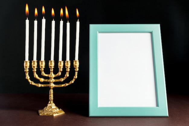 Bronze hanukkah menorah with burning candles