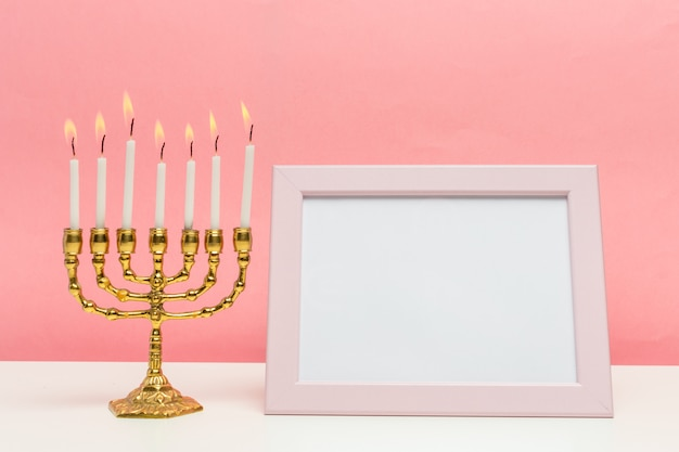 Bronze hanukkah menorah with burning candles