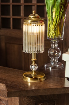 Bronze table lamp with crystal pendants