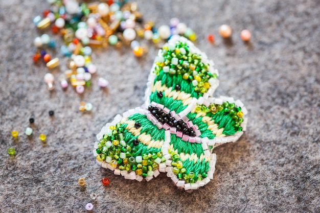 Brooch made of beads and thread