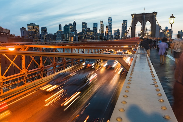 Brooklyn bridge with traffic and people in new york