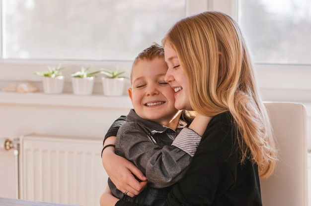 Brother and sister hug each other