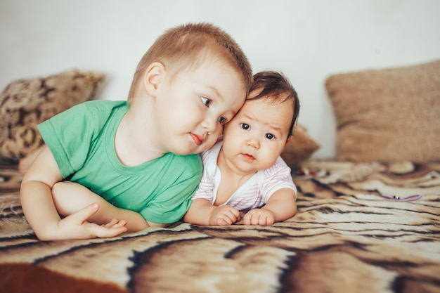 Brother and sister lie with, family love, younger and older