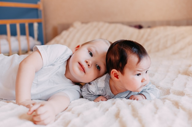 Brother and sister lie with
