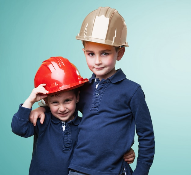 Brothers wearing protective helmets