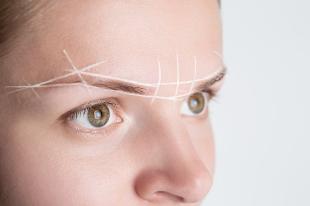 Brow marking and measuring before microblading