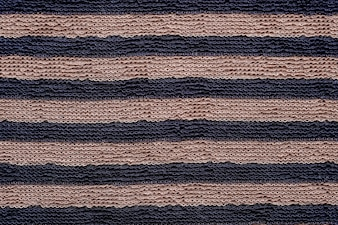 Brown and black striped pattern cotton fabric textured background
