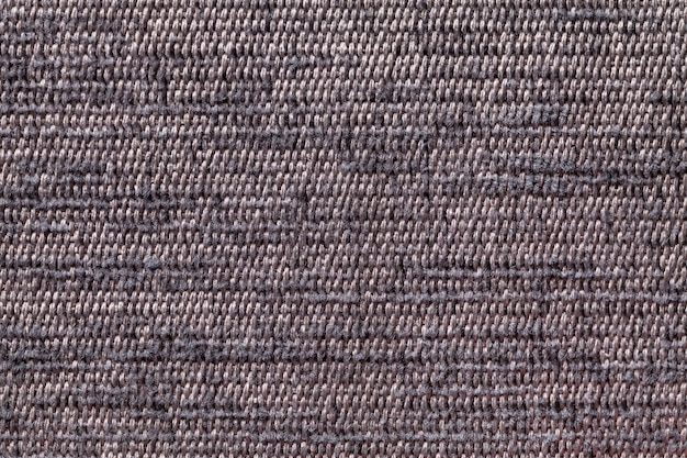 Brown background from soft textile material, fabric with natural texture,
