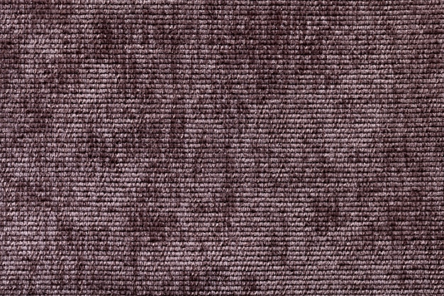 Brown background from soft textile material.