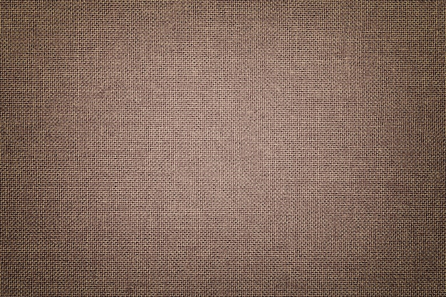 Brown background from a textile material with wicker pattern