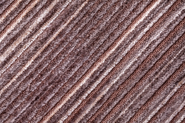 Brown background of a knitted textile material