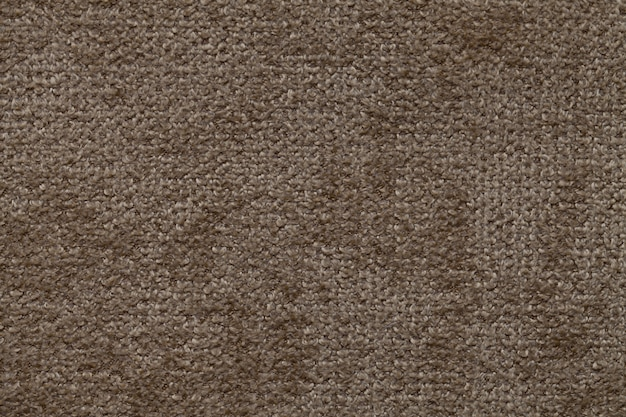 Brown background of soft, fleecy cloth, texture of textile closeup
