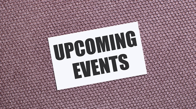 On a brown background, a white rectangular card with the text upcoming events